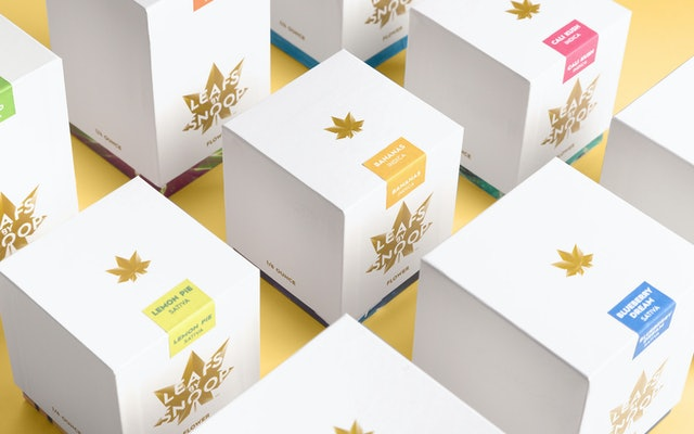 Flower boxes come in various sizes and are labeled with colored stickers for different flavors.