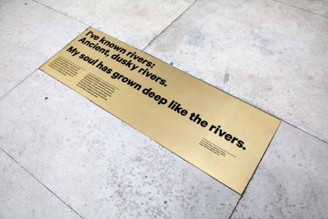 A special plaque quotes a poem by Langston Hughes and marks the building's location.