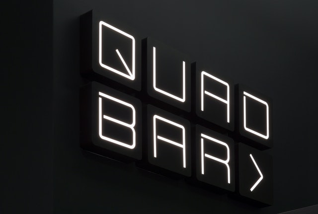Signage for the Quad Bar.