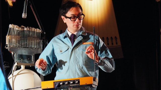 Yuri Suzuki plays a Theremin on the ident, which adds an evocative and eerie quality, similar to that of an opera singer.