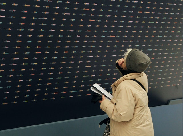The tilted display of ten thousand data portraits conveys the overwhelming magnitude of the subject.