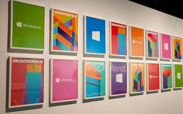 The forms of the logo echoed in a poster arrangement at the show.