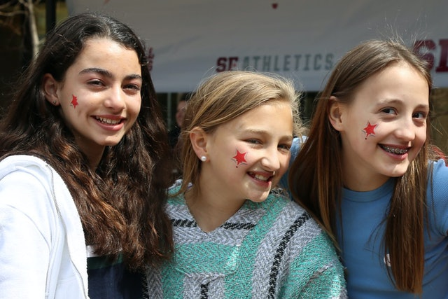 "Sidwell students show off their new ""Star Fox"" tattoos at the school's identity unveiling event."