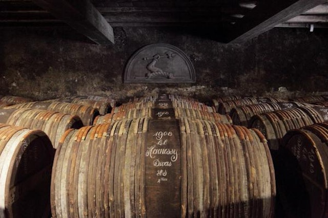 Hennessy ages V.S.O.P cognac in barrels marked with the distillery's brand signature.