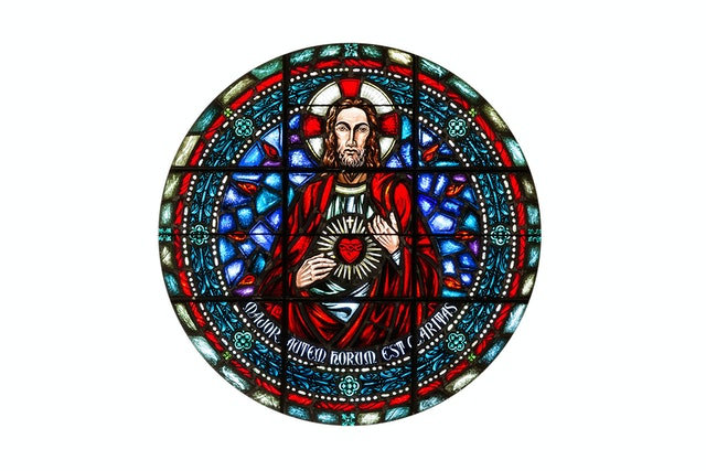 The Rose Window from LMU's Sacred Heart Chapel includes a version of the Jesuit seal.