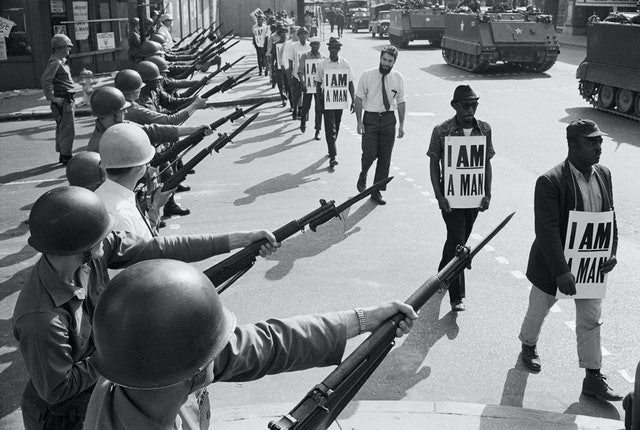 Protesters carrying signs at the historic sanitation workers strike in Memphis in 1968.