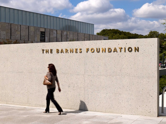 The name of the Foundation appears in metal lettering pin-mounted to the building at the entrance.