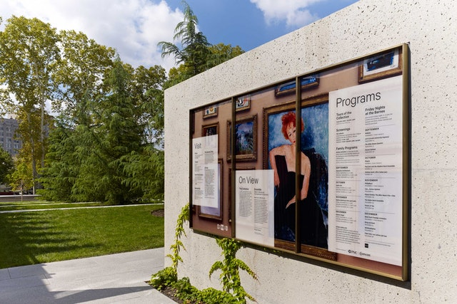 Museum information is posted on large panels at the entrance.