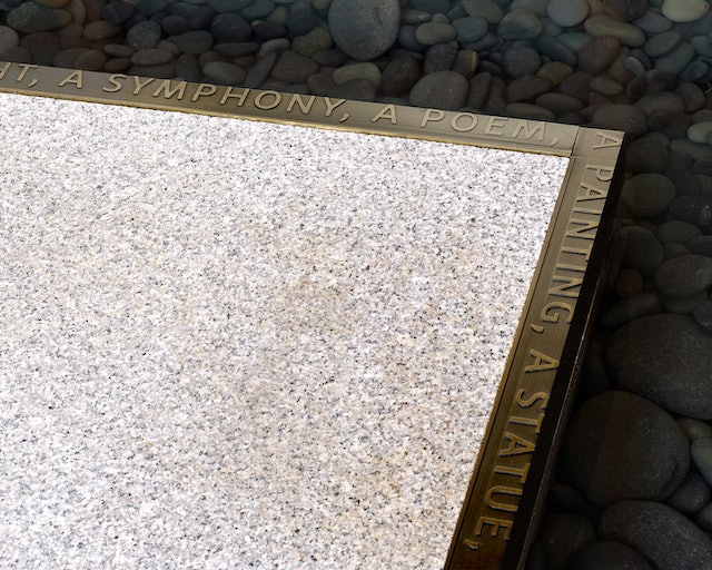 A quote from Dr. Barnes frames the edge of a fountain.