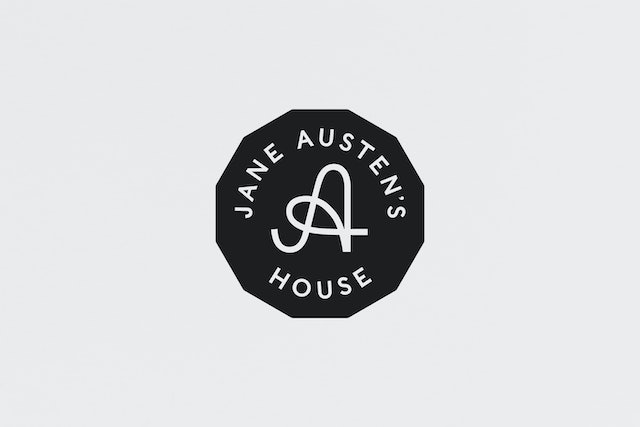The secondary logo which employs a holding shape based on Jane's writing table