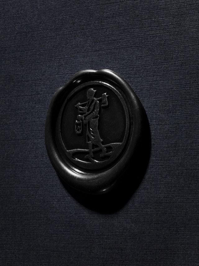 A detail of the wax imprint of the Kikori woodsman mark on the sampler box.