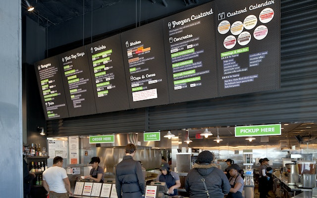 The menu board is a consistent graphic focus for all the restaurants.