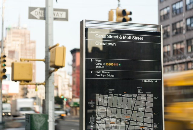 The signs are designed to guide users to public transit and major landmarks.