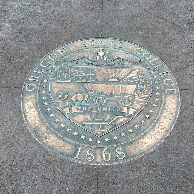 A bronze plaque in the center of campus displays OSU